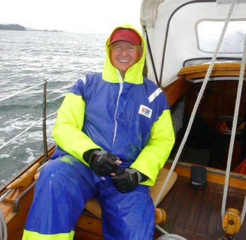 Sailor on a yacht in maryland wearing Stormline Captains rain gear for sailing