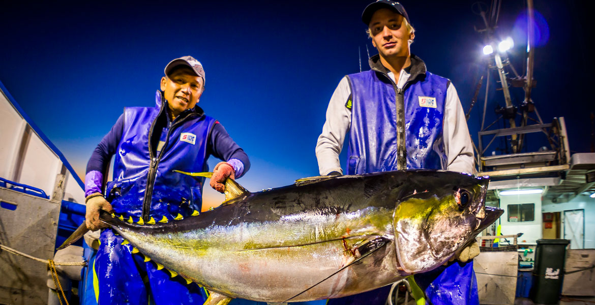 Two fisherman with a huge tuna wearing Stormline