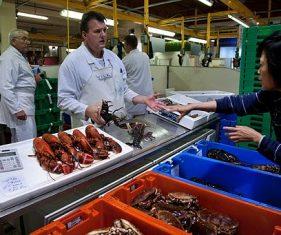 Fish monger and customer at Billingsgate Fish Market