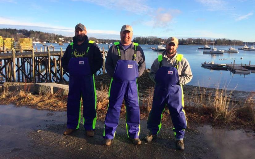 three fishermen posing for photograph