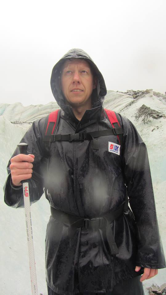 Regan McMillan wearing wet weather gear on Franz Josef glacier, NZ