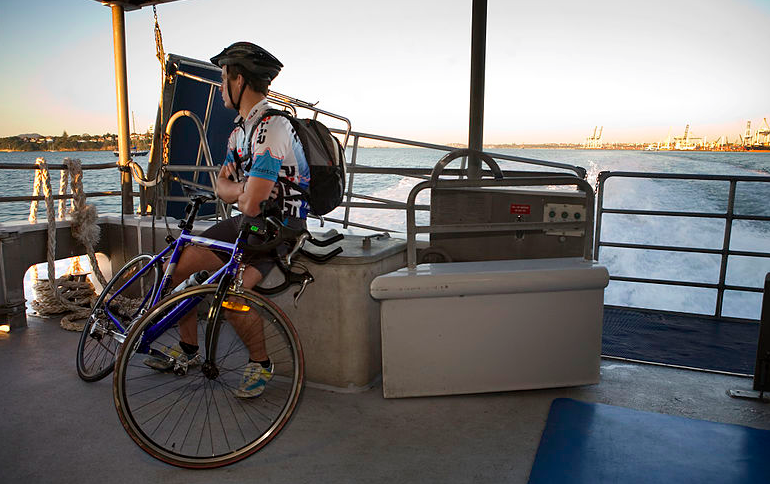 Commuter with bike on Great Barrier Island ferry