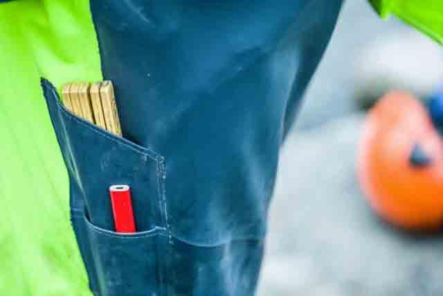 side pocket and knee pads on construction rain gear bibs