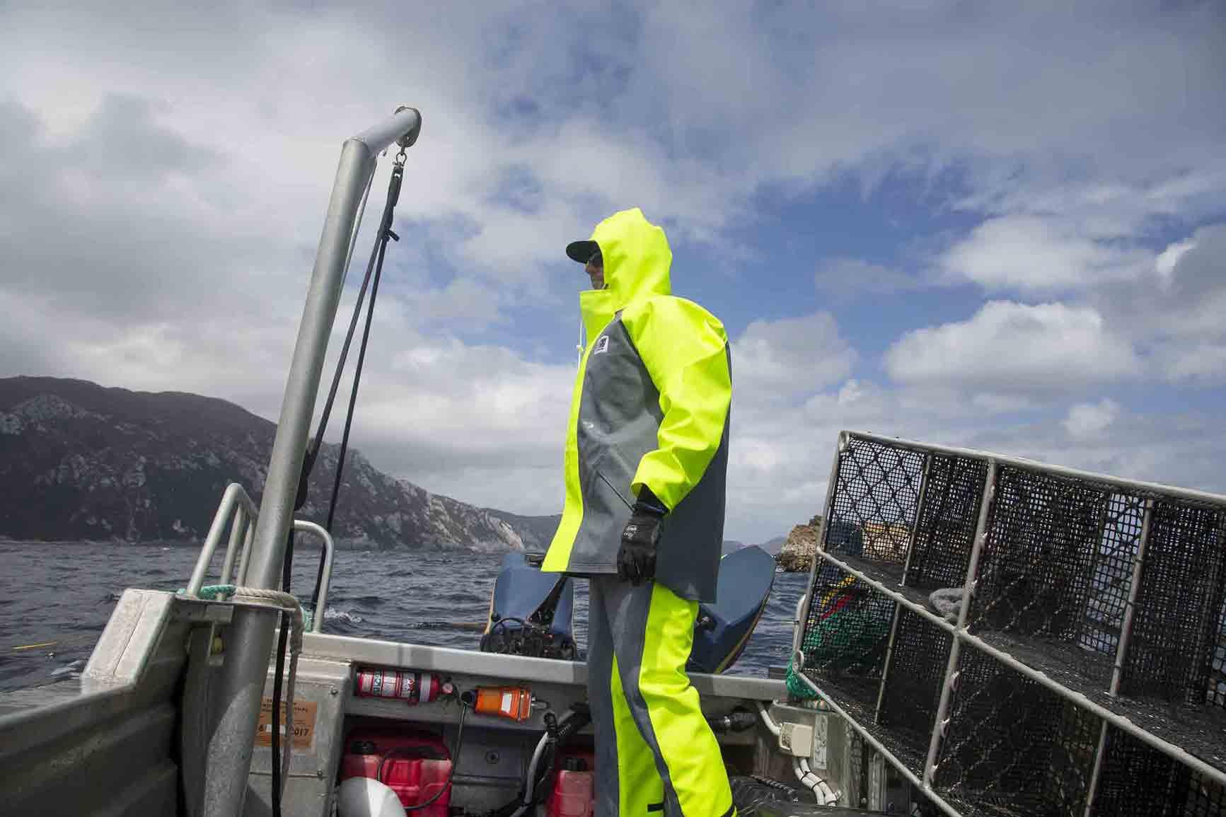 Fisherman wearing commercial rain gear on a boat
