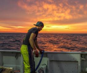 man fishing in wet weather gear